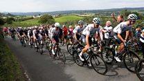 Tour of Britain peloton races past