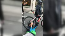 Cyclist dragged across road in mugging