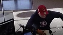 First robber drops his gun...