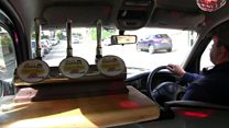 The taxi with a pub in the front seat