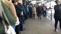 Storm Ali: Hundreds queue for buses to get home