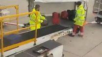 Baggage handler filmed damaging suitcase