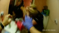 Body cam shows PC attacked with wine bottle