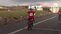 Bereaved dad completes ride on tiny bike