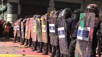 Protesters hurl paint at Barcelona police
