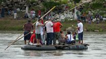 Migrants try to paddle into Mexico