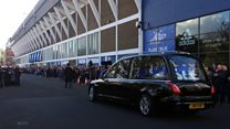 Fans pay respects at footballer's funeral