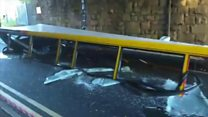 Bus roof ripped off after driver tries to negotiate low bridge