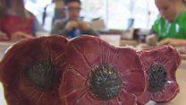 Blind children craft ceramic poppies