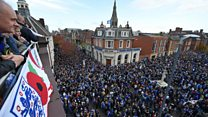 Leicester City fans march for owner
