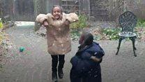 Refugee children dance in first snowfall