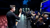 Rick Astley meets schoolchildren in Nottingham