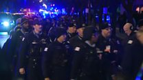 Police line streets to honour fallen officer