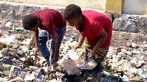 Yemeni children rummage through rubbish for food