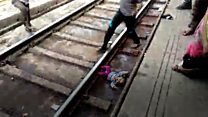 Indian baby's close call with train