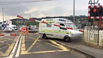 Ambulance smashes into level crossing