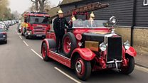 Vintage engine carries fireman's coffin