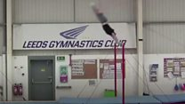 Gymnast sets horizontal bar backflip record