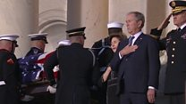 President George W Bush fights back tears