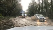 Vehicles hit flood waters after heavy rain