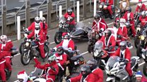 Hundreds of Santa Claus's on motorbikes