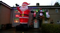 Giant Santa towers over house