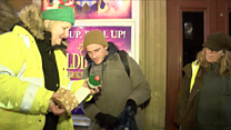 Volunteers hand out presents to homeless