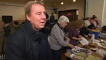 Harry Redknapp hands out jam roly polys
