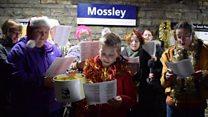 Christmas carollers sing of rail delay woes