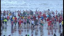Hundreds brave cold seas on Boxing Day