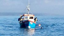 "Fisherman is rescued after ""amazing"" journey back to shore"
