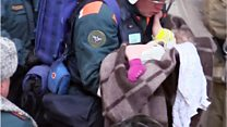 Russian rescuers pull baby from rubble