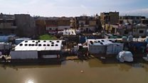 Refugee homes under water