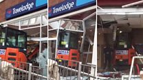 Digger driver smashes into hotel reception