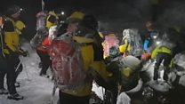Rescuers battle tough conditions to save climber