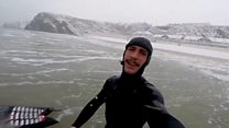 Surfer hits the snowy waves