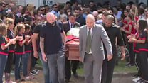 Mourners applaud Sala's coffin in tribute
