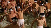 Near-naked men hunt for sticks in Japan