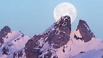 'Super snow moon' lights skies