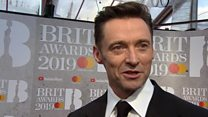What's Hugh Jackman doing at the Brits?