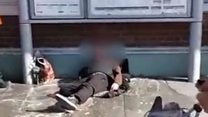 Train staff throw water at homeless man