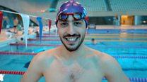 Swimmer stuns coach