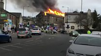 More than 50 firefighters tackling a mill fire