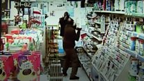 Shop worker fights off armed robber