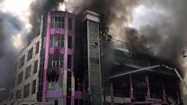 Helicopters combat shopping centre fire