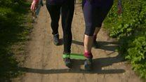 Women walking 120 miles with legs bound