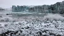 Tourists flee wave from glacier collapse