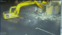 CCTV shows digger ripping out cash machine