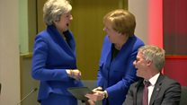 May and Merkel share a laugh over an iPad