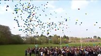 Hundreds release balloons for Carson
